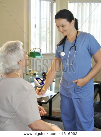 Young Nurse With Senior Patient