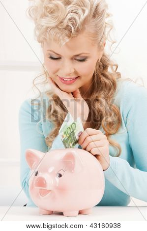 lovely woman with piggy bank and cash money
