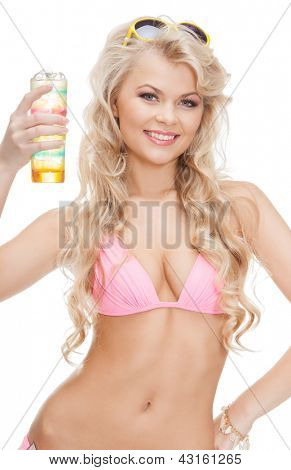 woman in bikini with glass of juice or cocktail