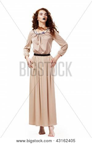 Romantic Elegant Barefoot Frizzy Woman In Brown Tunic Posing