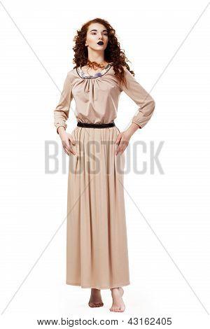 Romantic Elegant Barefoot Frizzy Woman In Brown Tunic Posing