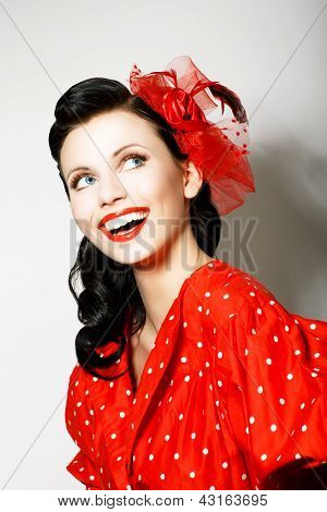 Retro Style. Elation. Portrait Of Happy Toothy Smiling Woman In Pin Up Red Dress
