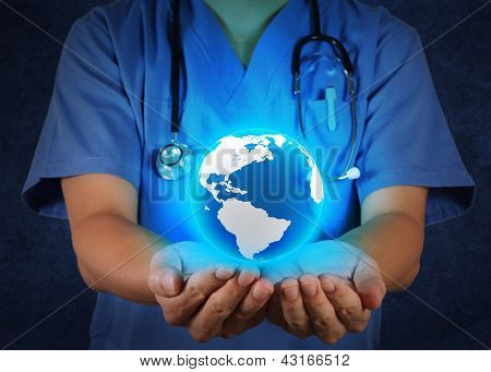 Medical Doctor Holding A World Globe In His Hands As Medical Network