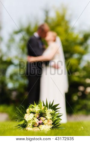 Wedding Bouquet With Wedding Couple