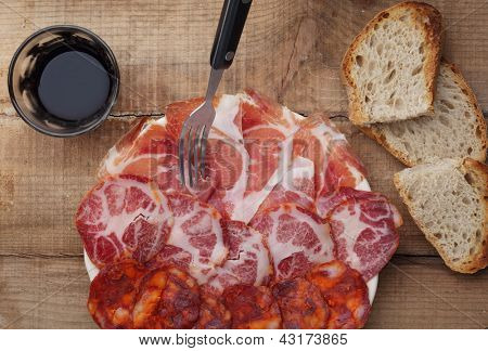 dish of sliced smoked ham and sausage - top view