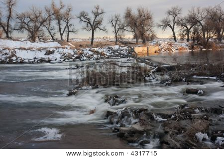 River Diversion Dam In Winter Scenery