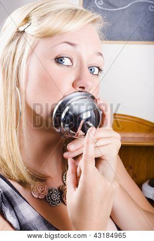 Young Blonde Woman Ringing The Bell Of Lip Service
