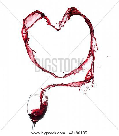 Red wine splashing from glass in heart shape, isolated on white background