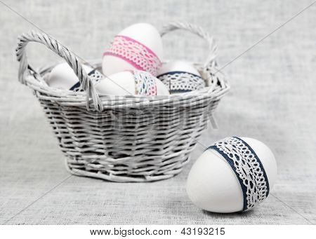 Basket With Easter Eggs And One Egg Close