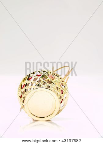 A Miniature Metalic Wicker Isolated On White Background