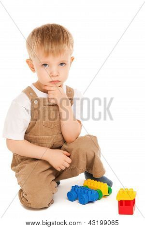 Thoughtful Child Playing With Toys Isolated