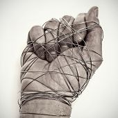 stock photo of sadistic  - man hand tied with wire - JPG