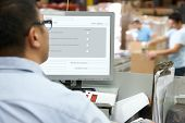 foto of terminator  - Person At Computer Terminal In Distribution Warehouse - JPG