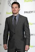 LOS ANGELES - MAR 9:  Stephen Amell arrives at the