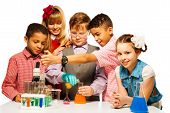 stock photo of flask  - Group of five diversity kids boys and girls blond and brunet with microscope and test tubes and flasks in chemistry class isolated on white - JPG