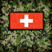 stock photo of ami  - Amy camouflage uniform with flag on it Switzerland - JPG