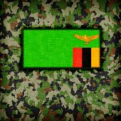stock photo of ami  - Amy camouflage uniform with flag on it Zambia - JPG