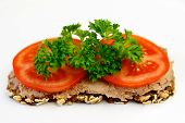 image of canard  - Delicious piece of dark bread with Foie Gras and Tomato on top - JPG