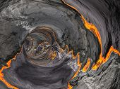 picture of hollow  - Conceptual 3D abstract perspective render of a futuristic curve tunnel or tube background with lava or fire - JPG