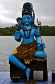 stock photo of brahma  - marble blue wood statue of a Hinduism snake Shiva vishnu Brahma in a temple near a lake in mauritius africa - JPG