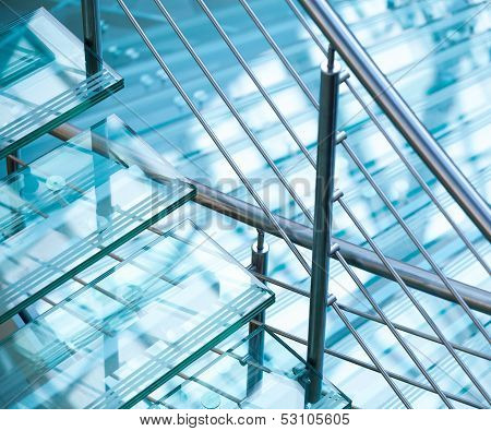 Modern Interior Abstract Fragment With Steel Railings And Stairs Made Of Glass