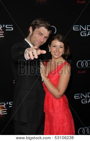 LOS ANGELES - OCT 28:  Liam McIntyre, Erin Hasan at the