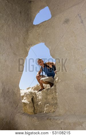 Tourist Posing Against The Backdrop Of The Caves The Cave City Chufut-kale, Crimea