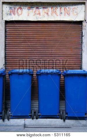 Blue Garbage Bins Parked In A No Parking Zone