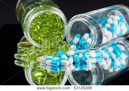 Natural Supplements And Vitamins On Black Background