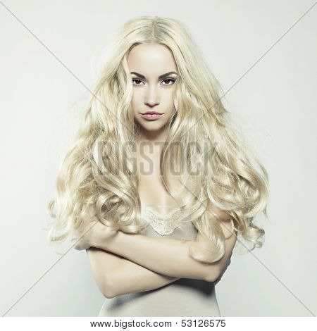 Fashion portrait of young beautiful woman. Sexy blonde.