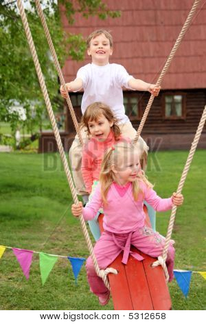 Three Children On  Swing