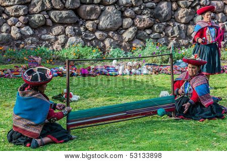 CUZCO, PERU - JULY 15: women weaving in the peruvian Andes at Cuzco Peru on july 15th, 2013. In the Andes of Peru every village has its own weaving patterns and traditions.