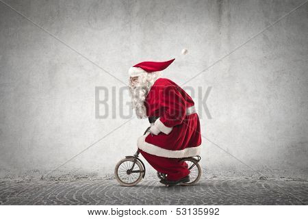 Santa Claus rides a bicycle