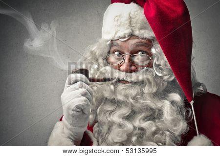 portrait of Santa Claus smokes a pipe