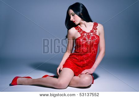 Sexy young woman in red lace nightie