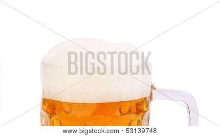 Top froth on the mug of beer isolated on white