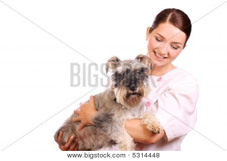 Vet Holding A Dog And Smiling