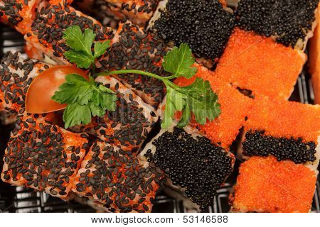 Food slices with fish caviar