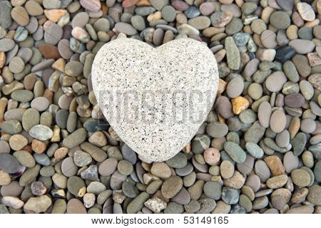 Heart on small sea stones, close up