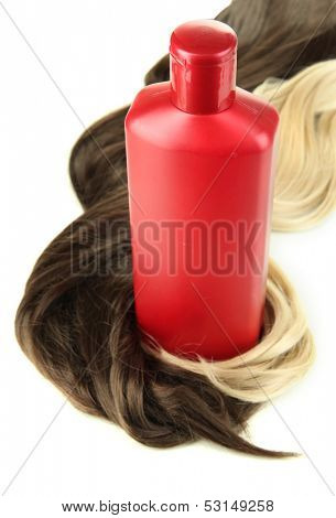 Curly blond and brown hair with shampoo isolated on white