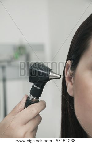 Close-Up of doctor checking ears of patient