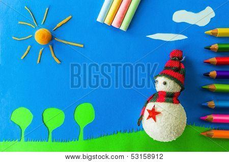 Snowman on green grass