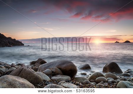 Sunset At Porth Nanven Cove In Cornwall