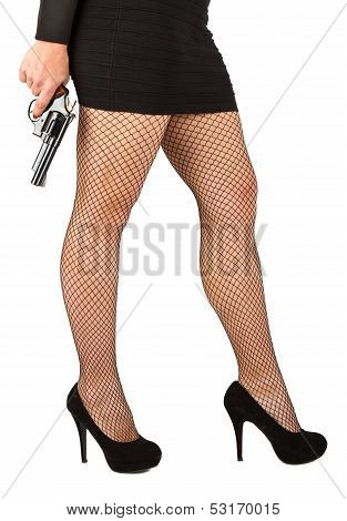 Legs Of Dangerous Woman With Handgun And Black Shoes