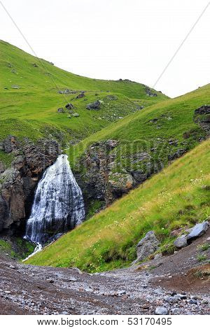 Waterfall Girlish Braids Between The Mountains Of Northern Caucas