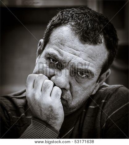 Black and white portrait of a sad man.