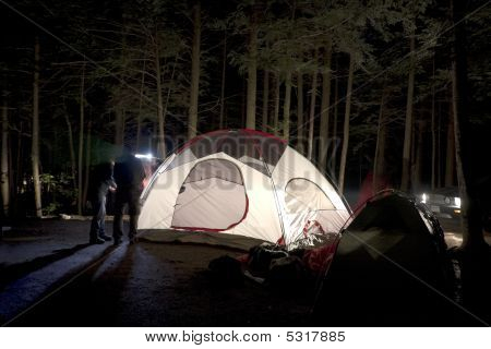 Putting Together Tent At Night