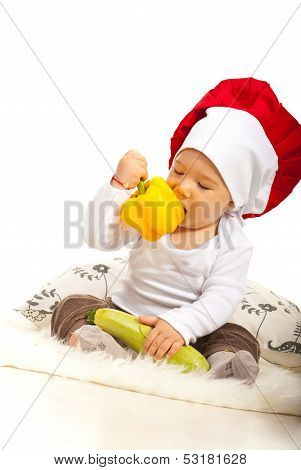 Chef Baby Eating Bell Pepper