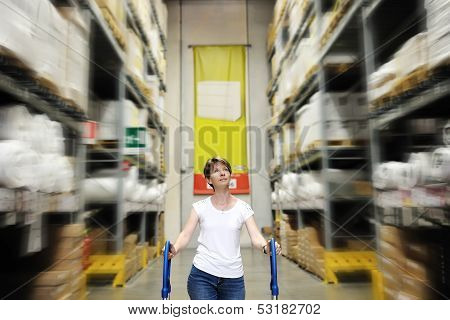 Woman Between Shelves Of Home Improvement Store
