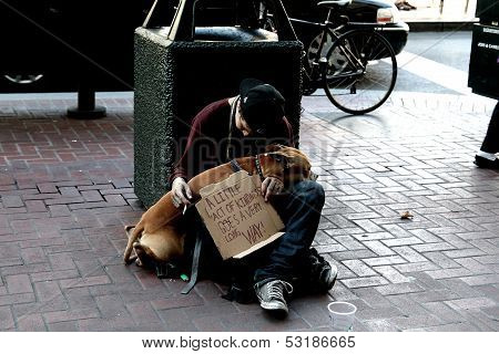 Homeless teenager on the streets with dog